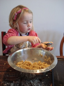 Ava rolls Anzac biscuits