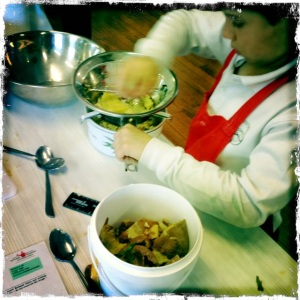 Passing potatoes through the mouli for gnocchi